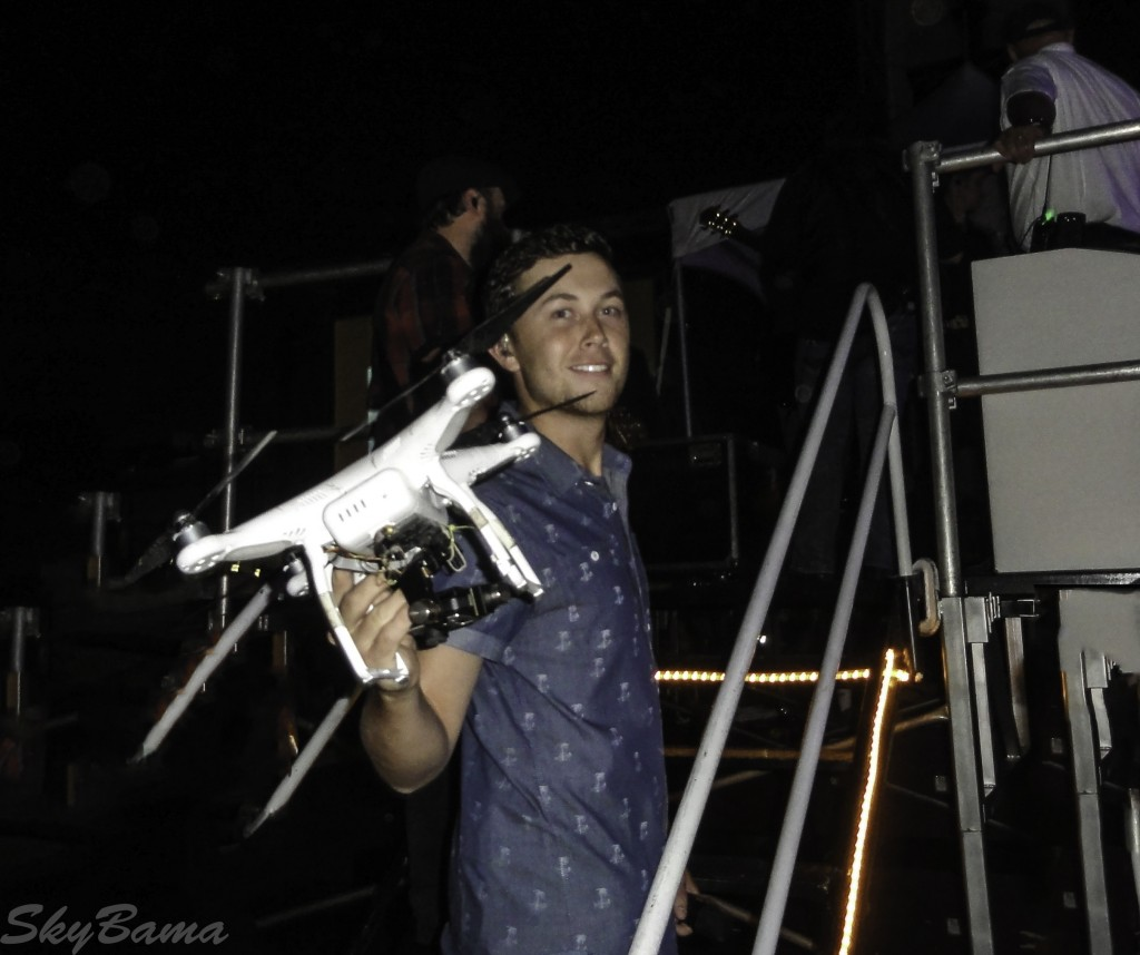 Scotty McCreery holding the drone at Alabaster Cityfest